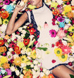 fashion model posing with flowers - 66994783