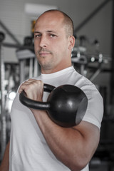 Male bodybuilder with kettlebell