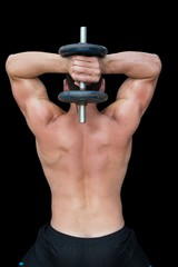 Strong crossfitter lifting up heavy black dumbbell behind head