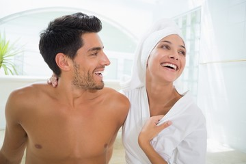 Attractive couple laughing in towels
