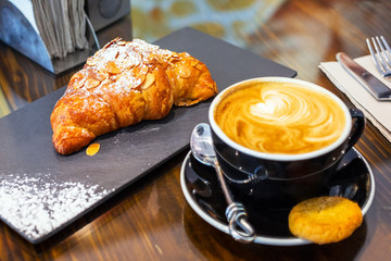 Coffee break with fresh croissant