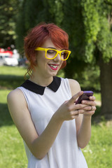 Hipster girl text messaging on her smart phone
