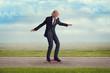 Leinwanddruck Bild - senior man riding a skateboard