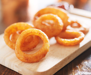 onion rings on wood board