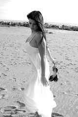 Beautiful woman posing on the beach black and white