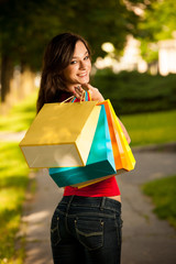 Beautiful young woman with shopping bags in the city