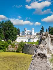 The White Swan palace on sky background. Sharovka, Ukraine.