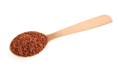 rice in wooden spoon on white
