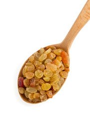raisins fruit in spoon on white
