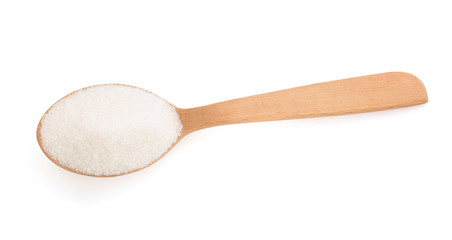 sugar and spoon on white