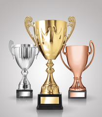 champion trophies on grey background