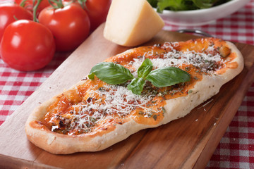 Plain pizza with tomato sauce and parmesan cheese