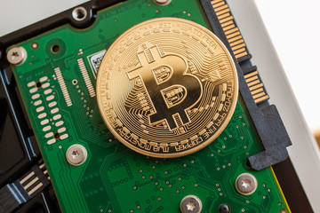 Bitcoin coin over fast computer hard disk drive