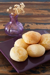 Brazilian snack cheese bread (pao de queijo) on plate vase