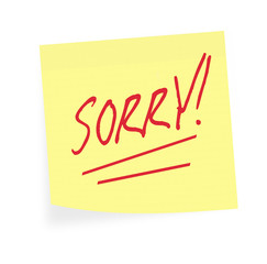Sorry note.  Apology on sticky. White background.