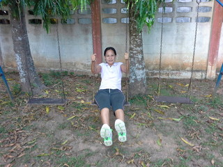 Thai woman on swing