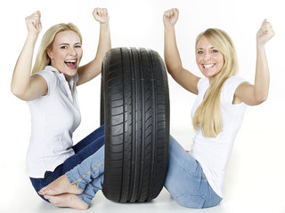 Two girls with tire sitting on the floor