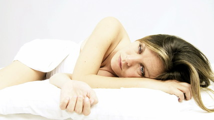 Beautiful blond woman falling asleep
