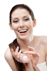 Woman starting to apply cream trying it on hands, isolated