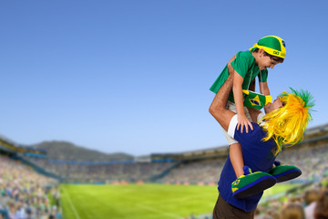 Brazilian fan at stadium with son