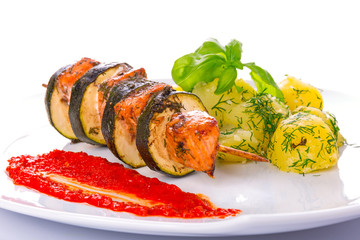 Salmon and courgette shashlik with boiled potatoes dish