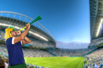 Brazilian fan at stadium playing vuvuzela