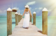 Girl on the wooden jetty. Great Exuma, Bahamas