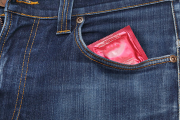 condom in a blue jeans pocket