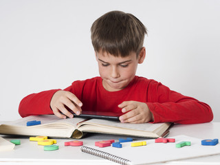 boy playing games on tablet instead of learning