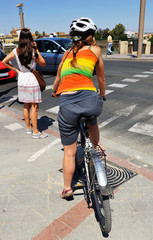 Cycling in the city, woman waiting at traffic lights