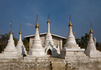 white Buddhist Stupas. Indein