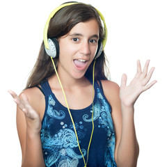 Hispanic girl listening to music on her headphones