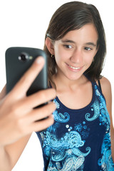 Hispanic teenage girl taking herself a photo with her phone