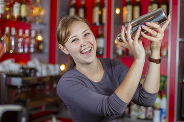 Bartender girl behind the counter