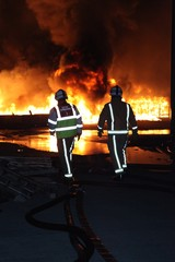 firefighters at large industrial fire