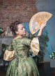 Beautiful woman in medieval dress with fan