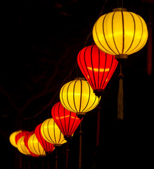 Chinese illuminated yellow and red lanterns