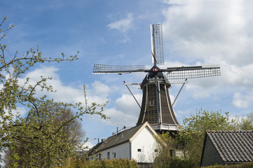 Wooden wind mill in urban setting