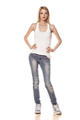 skinny blonde girl standing on white background