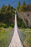 Hanging bridge over seasonal river - 67010742