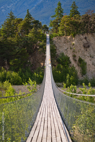 Hanging bridge over seasonal river - 67010742