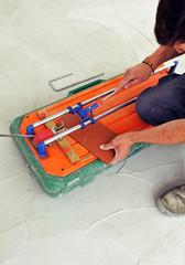 Tile cutting machine, construction