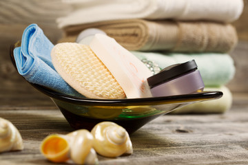 Spa Hygiene Accessories in Glass Bowl on Rustic Wood