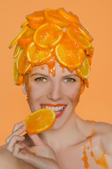 Woman eats orange