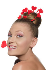 Woman with hearts in hair and teeth
