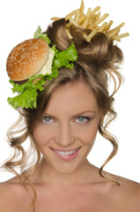 Woman with burger and fries smiling
