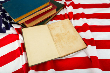 Vintage open book on American flag
