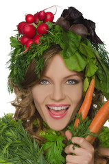 Woman with carrot, radish and greens