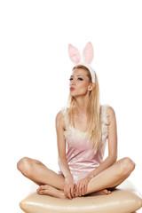 lovely blonde girl in rabbit costume sending a kiss
