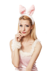 lovely blonde girl in rabbit costume with thinking gesture
